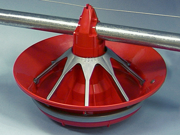 Chore-Time's MODEL G™ PLUS Feeder is shown with optional feed collar for use with turkeys or other large poultry.