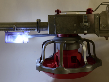 Chore-Time's Feeder Control Pan Light attracts birds to the control pan. Available for the REVOLUTION® Feeder (shown) and other Chore-Time® Feeders. Can also be retrofitted to a variety of feeding systems.