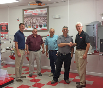Pictured left to right:  Kevin Alger, Regional Sales Manager for Chore-Time; Oren Heatwole, Ray Showalter and Gerald Knicely, owners of Poultry Specialties; and Dave Laurenz, Director of Marketing for Chore-Time